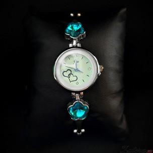 Часы с голубым цветком в платине